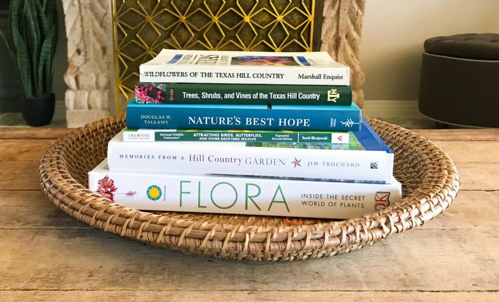 Native plant gardening books on coffee table