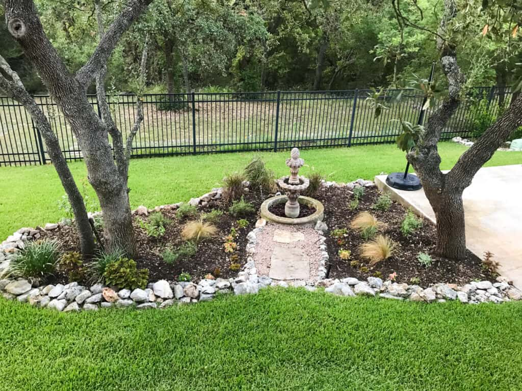 Native landscape design with a mix of Texas native plants and a few non-native plants.