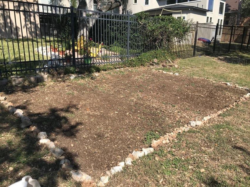 Bare soil prepped for native wildflower garden.