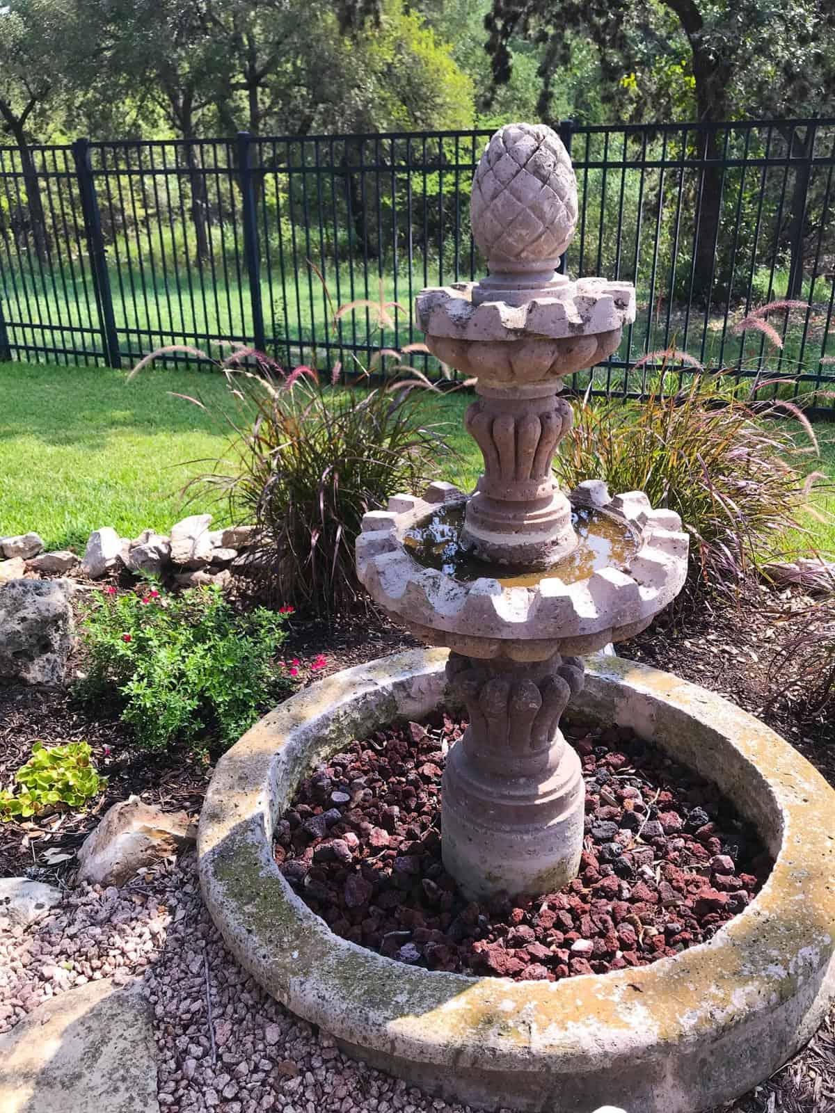Stone fountain used as a bird bath